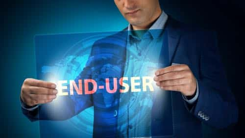Businessman holding a transparent screen with an inscription a end user. Business, technology, internet and networking concept.